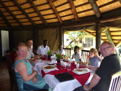 Gordon, Jana and Alex meet Thiona and Gabriel - together with their counsellor and the Czech charity representative - for lunch in Lusaka,