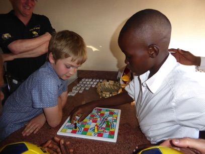 Alex and Gabriel engage in a game of snakes and ladders